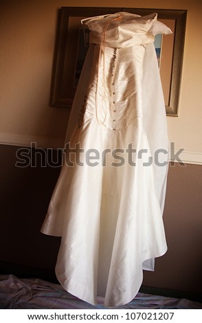 A bride's wedding dress on her wedding day