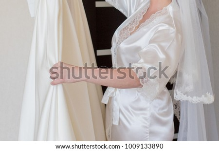 a bride with a dress in her hands