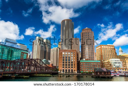 A bridge and the Boston Skyline, seen from Fort Point. - stock photo