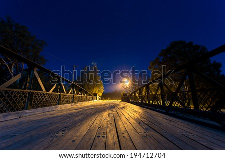 a bridge at night - stock photo