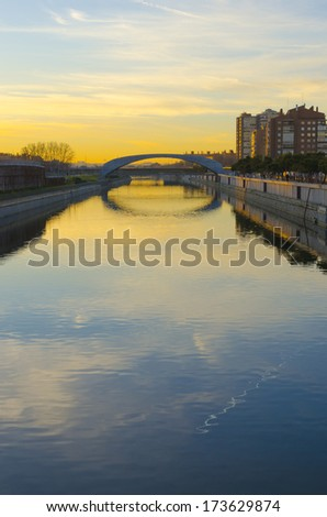 A bridge in the river Manzanares at sunrise. Madrid, Spain