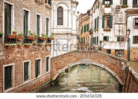 A bridge over a small canal, Venice Italy
