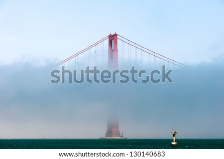 A Bridge pier of the Golden Gate Bridge partly covered by the fog.