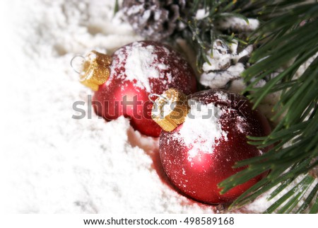 A bright and cheerful Christmas scene full of snowy baubles and pines.