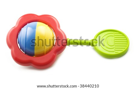 A bright colored baby rattle isolated on white background with copy space