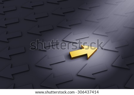 A bright, gold Arrow pointing right stands out in a dark field of gray arrows moving in the opposite direction  - stock photo