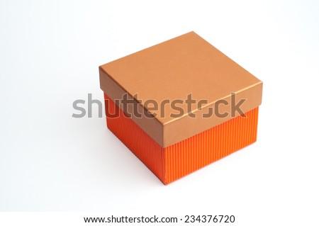 A bright orange color closed storage box isolated. - stock photo