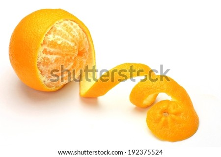 A bright orange that has been peeled into a spiral. - stock photo