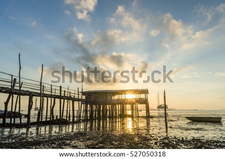 A bright sunrise over an old jetty in Pasir Gudang, Johor. The tide was low.