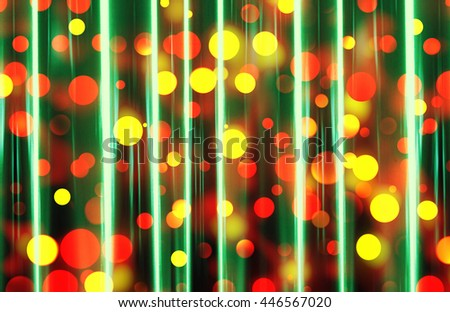 A brightly illuminated festive bokeh design in shades of red and yellow seen through a sheer green curtain - stock photo