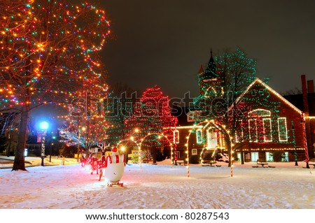 A brightly lit small-town Christmas display on the village square - stock photo
