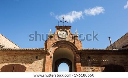 A broken clock in a medieval palace of Recanati, Italy - stock photo