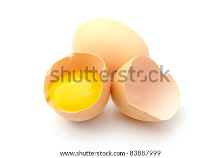 a broken egg on a white background isolated - stock photo