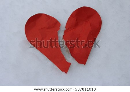a broken heart in the snow