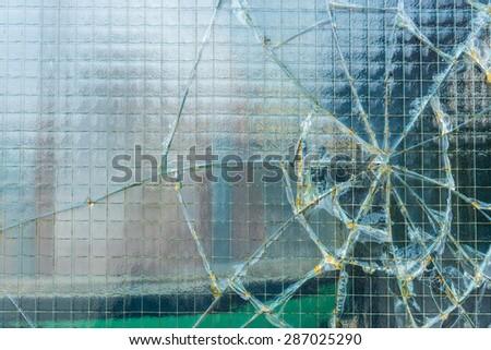 A broken industrial window.  - stock photo