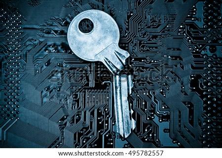 A Broken Key On Computer Circuitboard Background Security Breach Concept