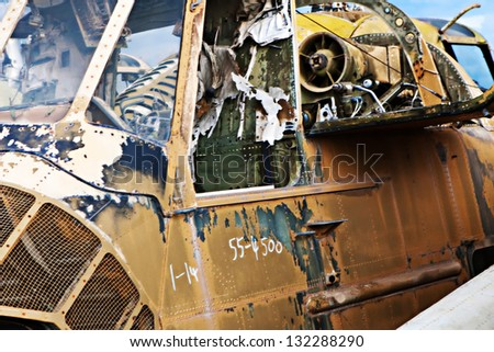 A broken military helicopter sits in a graveyard - stock photo