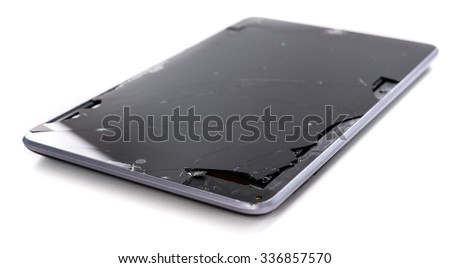 A broken tablet computer as detailed close-up shot on neutral white background - stock photo