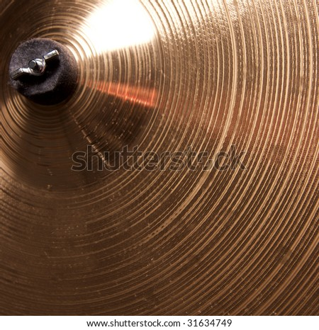 A bronze brass cymbal close up in the square format. - stock photo