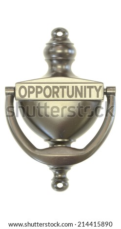 A bronze door knocker with the word opportunity on it symbolizing new opportunities - stock photo