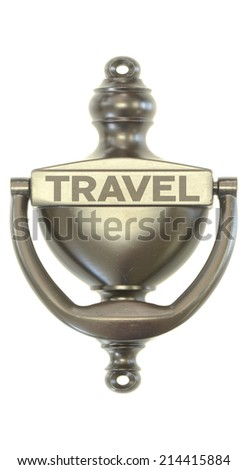 A bronze door knocker with the word travel on it symbolizing new opportunities - stock photo