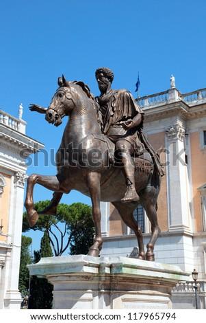 A bronze statue of Marcus Aurelius at the Piazza del Campidoglio outside of the Capitoline Museum in Rome - stock photo