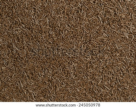 A brown background of cake decoration chocolate sprinkles