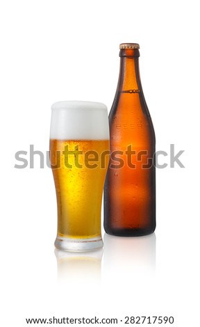 A brown beer bottle and glass covered with water drops, isolated on white