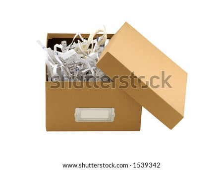 A brown box filled with shredded paper - stock photo