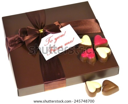 A brown box with a ribbon of chocolates for Valentinesdag - stock photo