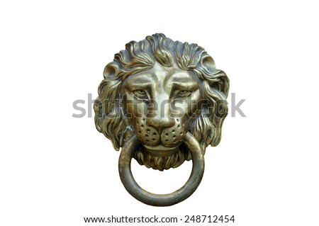 A brown door with beautiful bronze retro style carved lion head handle (knocker)  - stock photo