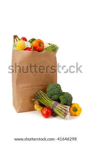 A brown grocery sack full of vegetables including broccoli, asparagus, peppers, tomatoes, celery, bananas on white background with copy space - stock photo