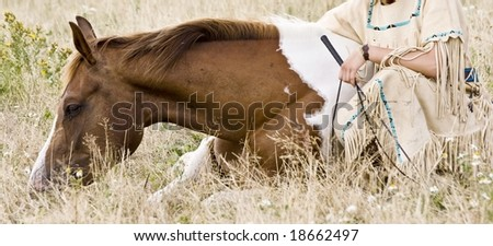 a brown horse with indian girl on meadow