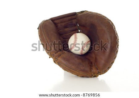 A brown leather baseball mitt with a white leather baseball on a white background with copy space