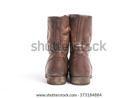 A brown leather shoes for military front side on the bottom isolated white.