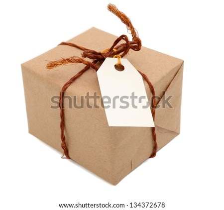 A brown package wrapping box with white tag - stock photo