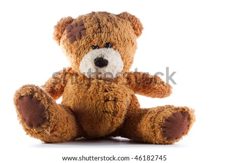 a brown teddy bear with patch on a head sited on white - stock photo