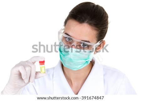 A brunette medical or scientific researcher or doctor using looking at a clear solution