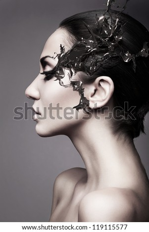 a brunette woman head profile with chocolate splash