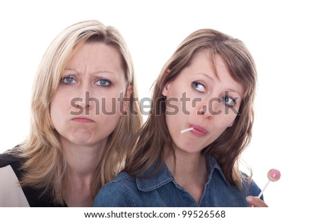 a brunette woman with lolly and a blond woman without any sweets - stock photo