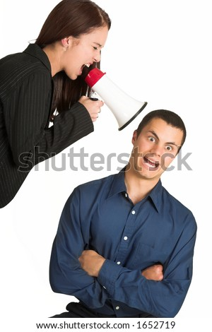 A brunette woman  yelling at her male business partner over a microphone - stock photo