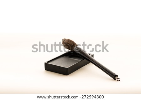 a brush and an ink-stone