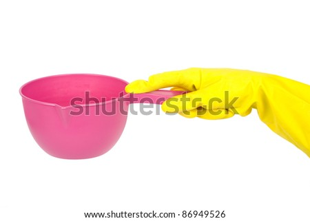 a bucket in a hand is isolated on a white background