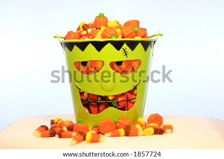 A bucket of candy corn for Halloween - stock photo