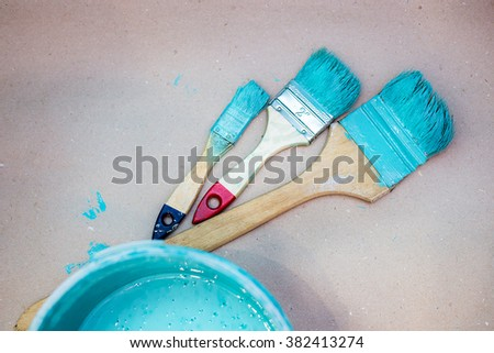 a bucket of paint and a paint tray and roller brush set