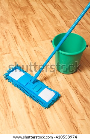A bucket of water and mop. Wash wood floor concept - stock photo