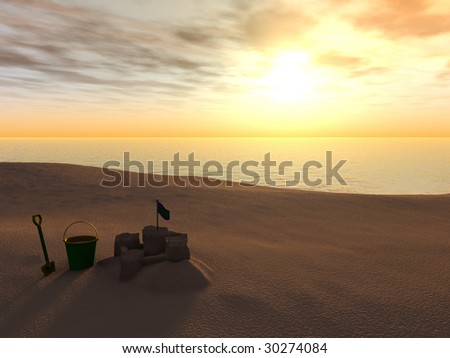 A bucket, spade and sand castle on a beach at sunset. - stock photo