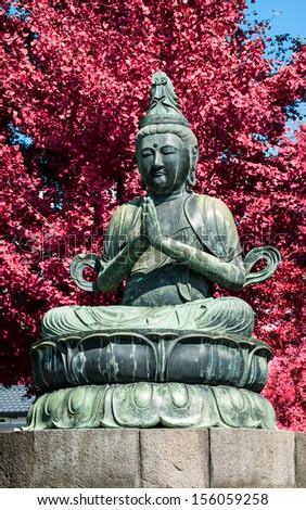 A Buddha statue outside Sensoji Temple in Tokyo, Japan. - stock photo