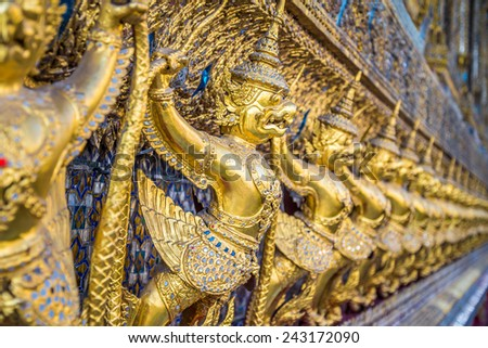 A buddhist icon used as decoration in Royal Palace of Bangkok, Thailand - selective focus - stock photo