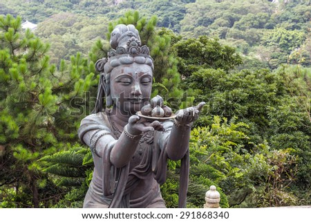 A buddhistic statues praising and making offerings to the Tian Tan Buddha (the Big Buddha). - stock photo